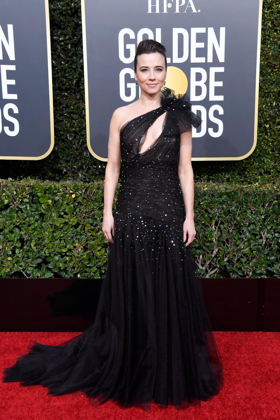 <p>Wearing a Monique Lhuillier dress with Sophia Webster shoes and Irene Neuwirth jewels.</p>