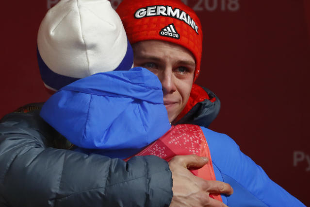 <p>Andreas Wellinger, of Germany, cries as he hugs a competitor after winning the gold medal in the men's normal hill individual ski jumping competition at the 2018 Winter Olympics in Pyeongchang, South Korea, Sunday, Feb. 11, 2018. (AP Photo/Matthias Schrader) </p>