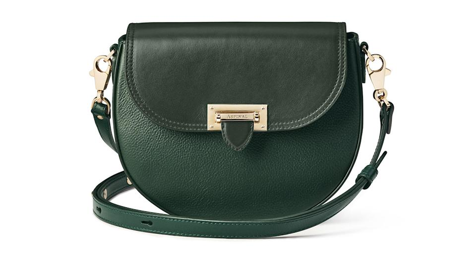 """If you've got a little more cash to splash this Christmas, this gorgeous, bottle-green bag from Aspinal of London is bound to put a smile on your mum's face. And if it's good enough for the Duchess of Cambridge... <a href=""""https://fave.co/2ZUIbJA"""" rel=""""nofollow noopener"""" target=""""_blank"""" data-ylk=""""slk:Shop now."""" class=""""link rapid-noclick-resp""""><strong>Shop now.</strong></a>"""