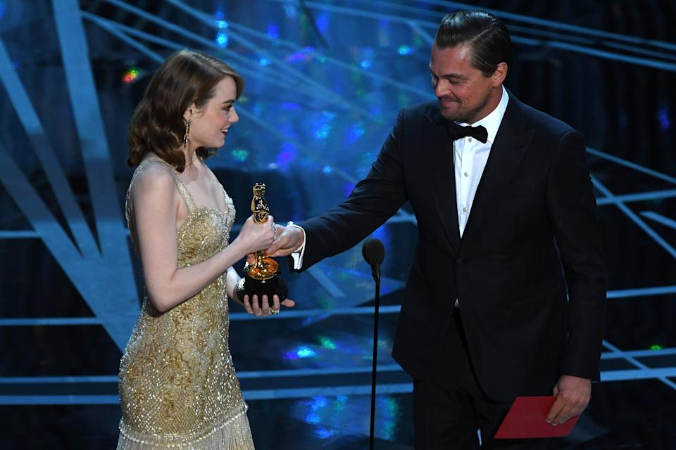 Leo presented Emma with her Oscar for Best Actress in 2017 (Photo: MARK RALSTON via Getty Images)