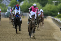 Flavien Prat atop Rombauer, center, reacts after winning the Preakness Stakes horse race at Pimlico Race Course, Saturday, May 15, 2021, in Baltimore. (AP Photo/Nick Wass)