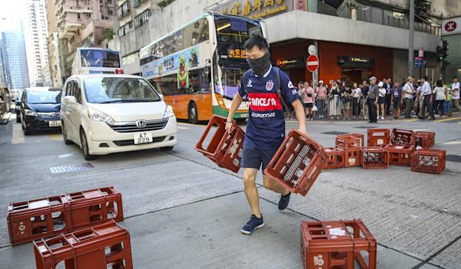 Anti-government protesters blocked a road in North Point on Monday. Photo: Winson Wong