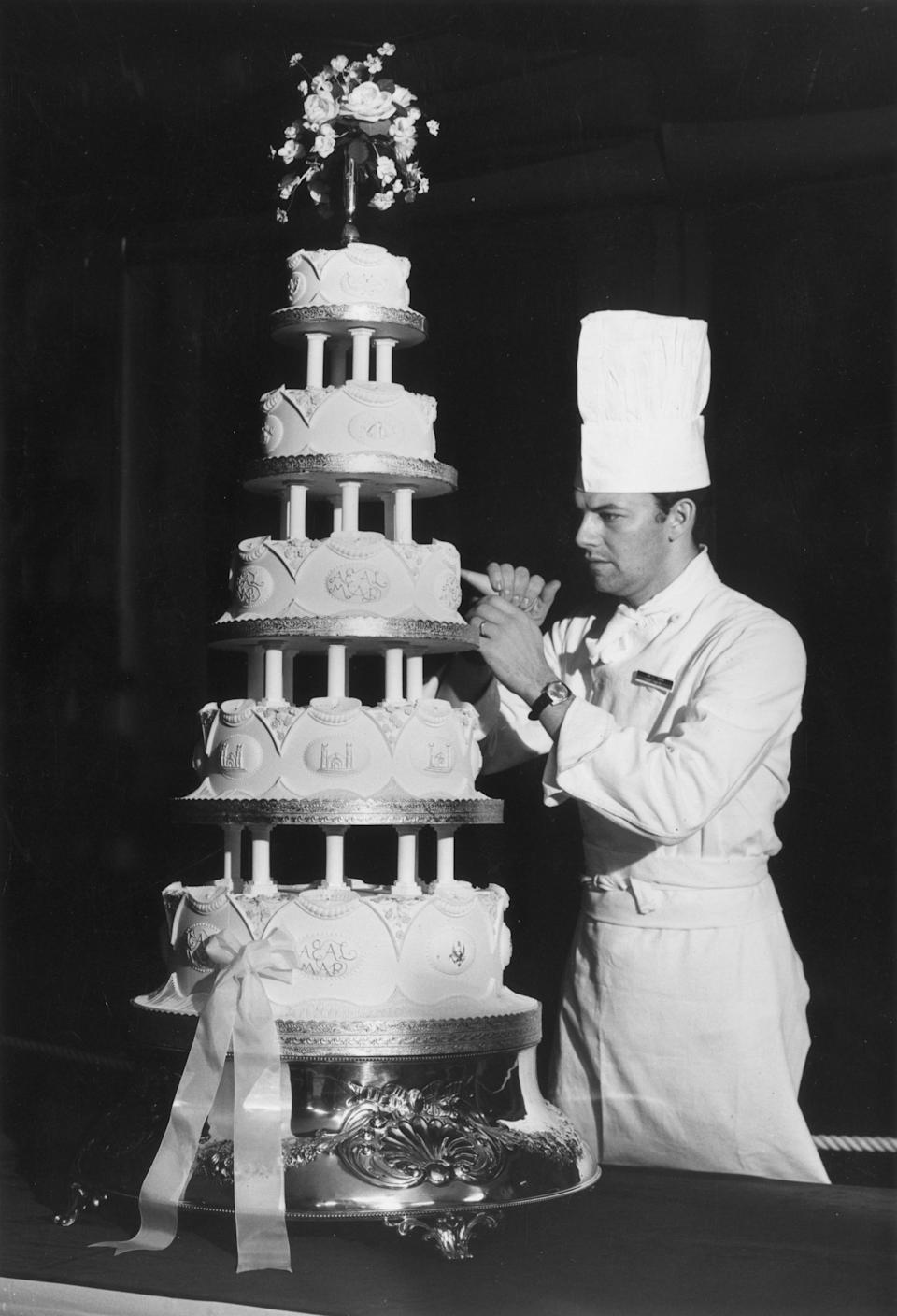 <p>Princess Anne and Captain Mark Phillips commissioned warrant officer David Dodd (an instructor at the Army School of Catering) to make their wedding cake. It boasted five tiers and incredibly intricate piping work. <em>[Photo: Getty]</em> </p>