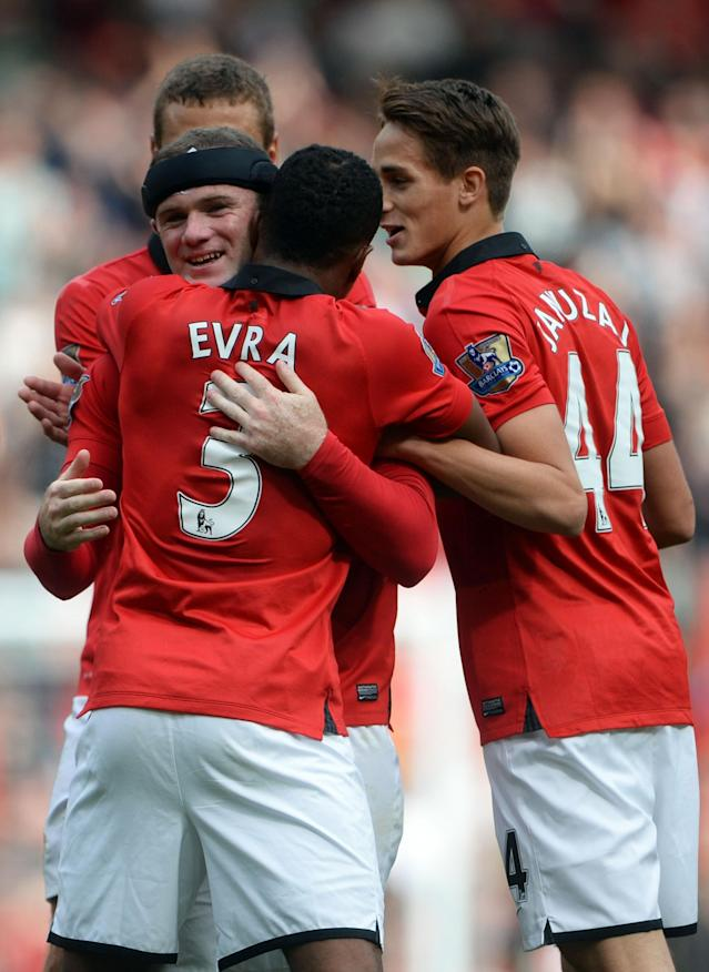 MANCHESTER, ENGLAND - SEPTEMBER 14: Wayne Rooney of Manchester United is congratulated by Patrice Evra as he scores their second goal during the Barclays Premier League match between Manchester United and Crystal Palace at Old Trafford on September 14, 2013 in Manchester, England. (Photo by Michael Regan/Getty Images)