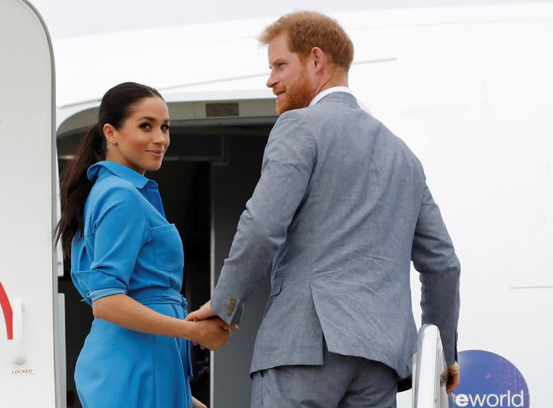 FILE PHOTO: Britain's Prince Harry and Meghan, Duchess of Sussex look on before departing from Fua'amotu International Airport in Tonga