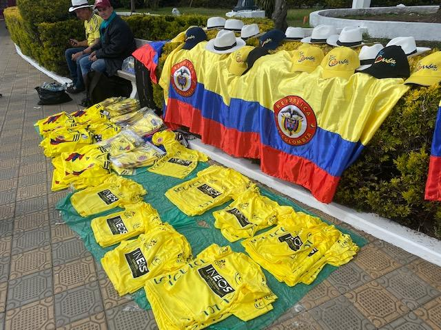 Vendors at Tour Colombia 2.1 sell replicas of Egan Bernal's Tour de France yellow jersey