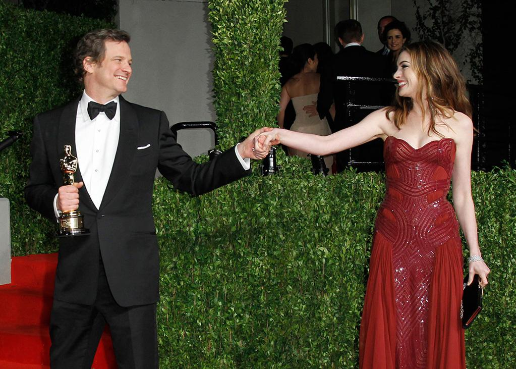 Best Actor winner Colin Firth and Anne Hathaway (in Atelier Versace) congratulated each other on the Vanity Fair red carpet.