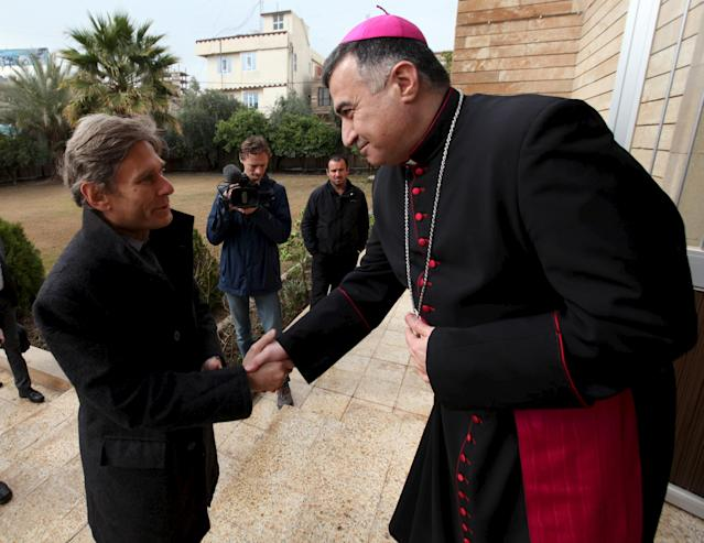 U.S. Assistant Secretary of State for Democracy, Human Rights and Labor Tom Malinowski, left, shakes hands with Archbishop Bashar Warda during his visit to the Chaldean Church in Erbil, Iraq. (Photo: Azad Lashkari/Reuters)