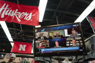 The Husker Hounds sports apparel store in Omaha, Neb., shows on television screens Wednesday, Sept. 16, 2020, a Big Ten virtual news conference to discuss the reopening of the football season. Less than five weeks after pushing football and other fall sports to spring in the name of player safety during the pandemic, the conference changed course Wednesday and said it plans to begin its season the Oct. 23-24 weekend. Each team will have an eight-game schedule. (AP Photo/Nati Harnik)