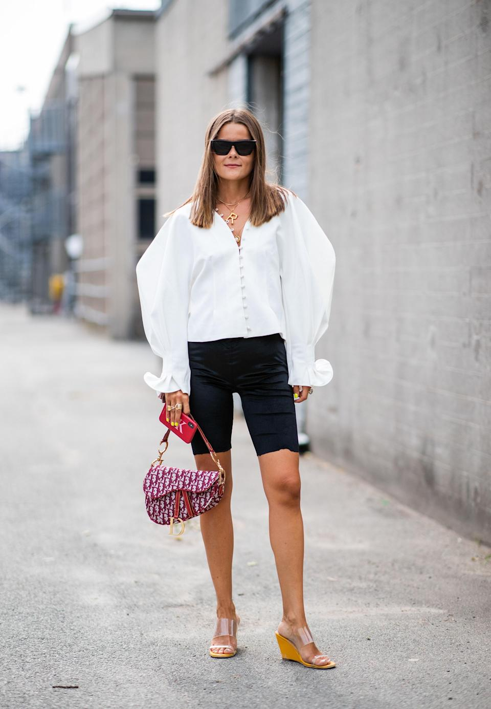 "Nostalgia is a recurring trend in fashion, which means all of your favorite shoes from the nineties are back. Lean into the decade by pairing them with your favorite <a href=""https://www.glamour.com/gallery/sweater-sets?mbid=synd_yahoo_rss"" rel=""nofollow noopener"" target=""_blank"" data-ylk=""slk:sweater sets"" class=""link rapid-noclick-resp"">sweater sets</a> and <a href=""https://www.glamour.com/gallery/giant-scrunchie-trend?mbid=synd_yahoo_rss"" rel=""nofollow noopener"" target=""_blank"" data-ylk=""slk:giant scrunchies"" class=""link rapid-noclick-resp"">giant scrunchies</a>."