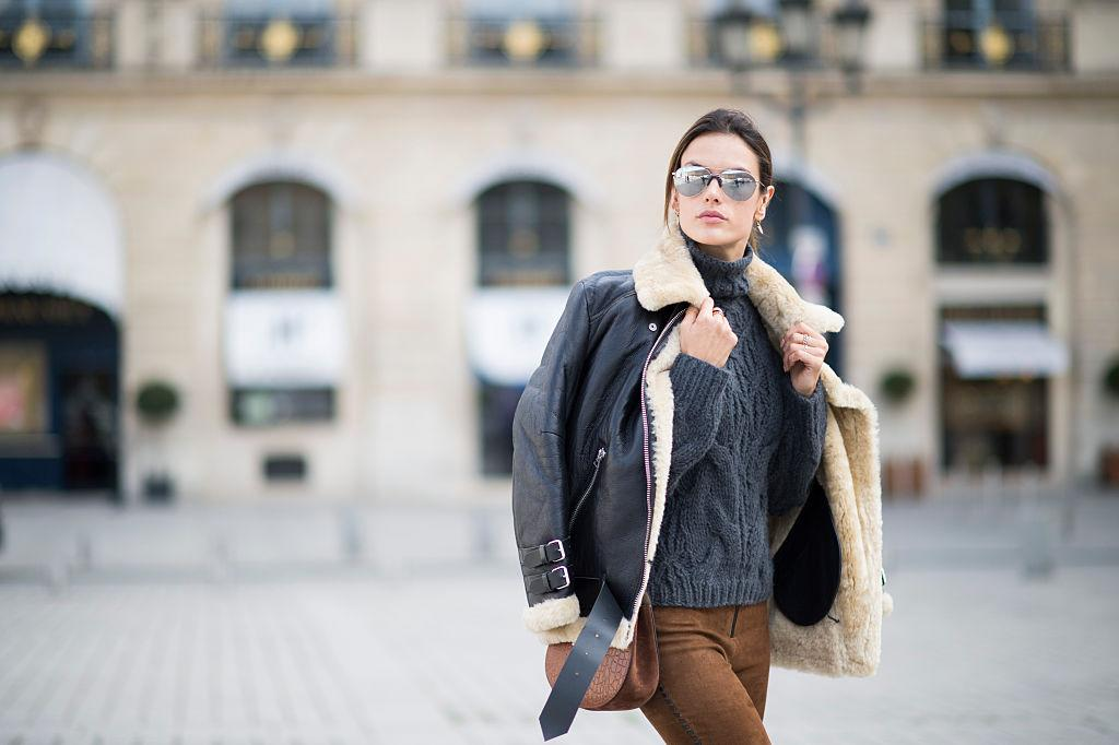 <p>Alessandra Ambrosio wore her Acne coat to Paris Fashion Week last March. She styled her dark coat with a Calvin Rucker gray sweater, Magda Butrym suede pants, Gianvito Rossi boots, and a Chloe bag. (Photo: Getty Images) </p>