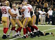 Nov 9, 2014; New Orleans, LA, USA; San Francisco 49ers kicker Phil Dawson (9) celebrates with teammates after kicking the game-winning field goal in overtime against the New Orleans Saints at Mercedes-Benz Superdome. The 49ers won 27-24. Mandatory Credit: Chuck Cook-USA TODAY Sports