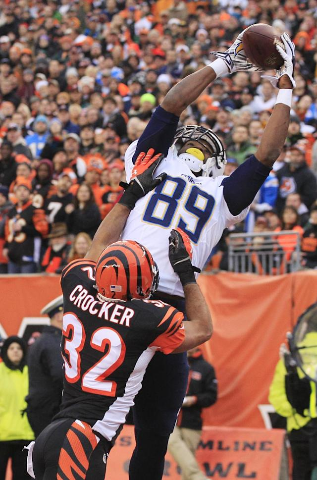 San Diego Chargers tight end Ladarius Green (89) catches a 4-yard touchdown pass against Cincinnati Bengals safety Chris Crocker (32) in the second half of an NFL wild-card playoff football game on Sunday, Jan. 5, 2014, in Cincinnati. (AP Photo/Tom Uhlman)