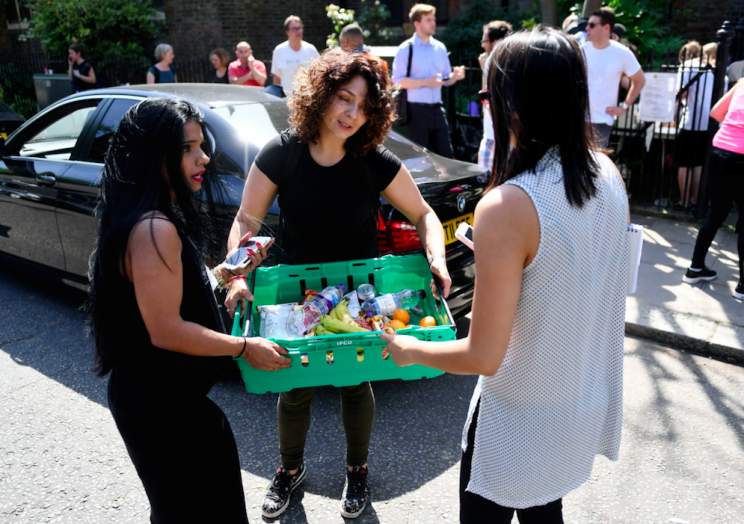 The public has donated supplies to evacuated residents (Picture: Rex)