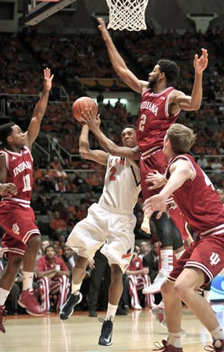"""Illinois' Joseph Bertrand (2) tries to get to the basket between Indiana's Kevin """"Yogi"""" Ferrell (11), Christian Watford (2) and Cody Zeller (40) during the first half of an NCAA college basketball game at Assembly Hall in Champaign, Ill., on Thursday, Feb. 7, 2013. (AP Photo/John Dixon)"""