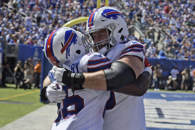 Buffalo Bills' Devin Singletary, left celebrates his touchdown with Mitch Morse during the first half of an NFL football game against the New York Giants, Sunday, Sept. 15, 2019, in East Rutherford, N.J. (AP Photo/Bill Kostroun)