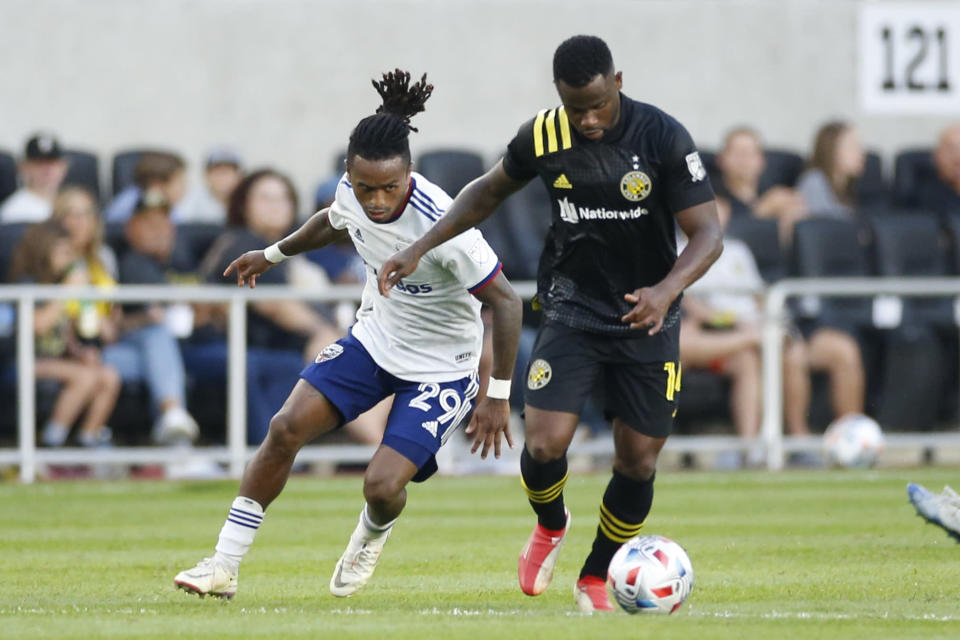 Columbus Crew's Waylon Francis, right, tries to keep the ball away from D.C. United's Yordy Reyna during the first half of an MLS soccer match Wednesday, Aug. 4, 2021, in Columbus, Ohio. (AP Photo/Jay LaPrete)
