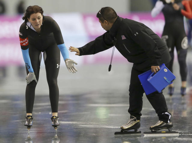 Heather Richardson of the United States touches her coach after the women's 1,000-meter race of the World Sprint Speed Skating Championships in Nagano, central Japan,Sunday, Jan. 19, 2014. (AP Photo/Koji Sasahara)