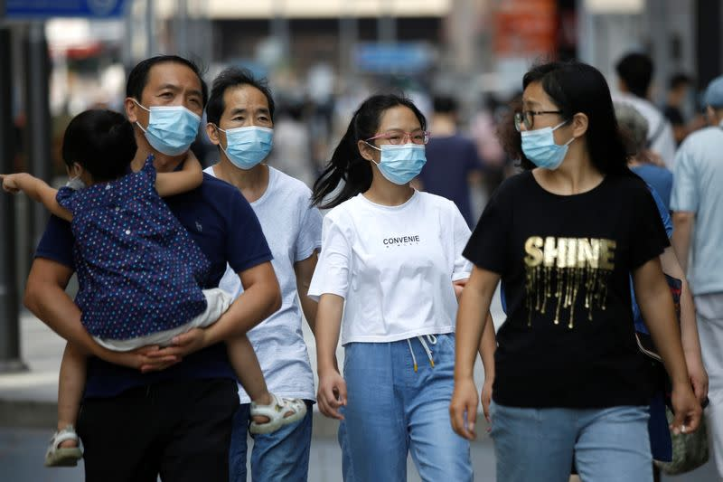 People are seen after Beijing announced that wearing face masks are no longer mandatory outdoor in Beijing, following the coronavirus disease (COVID-19) outbreak