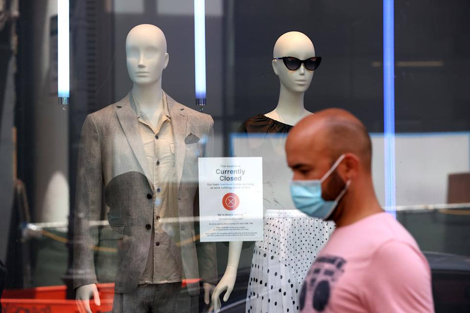 A person walks by a closed Banana Republic store on June 11, 2020 in San Francisco, California. Economic worries due to the coronavirus COVID-19 pandemic continue as an additional 1.5 million people filed for first-time unemployment benefits in the past week. (Photo by Justin Sullivan/Getty Images)
