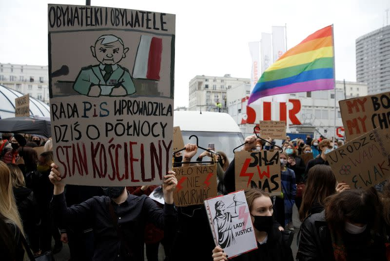 People take part in a protest against the ruling by Poland's Constitutional Tribunal that imposes a near-total ban on abortion in Warsaw