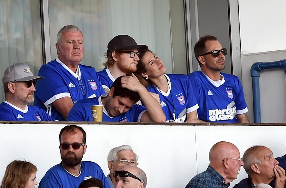 Ipswich Town fan Ed Sheeran (top row third right) and Cherry Seaborn in the stands watching the match