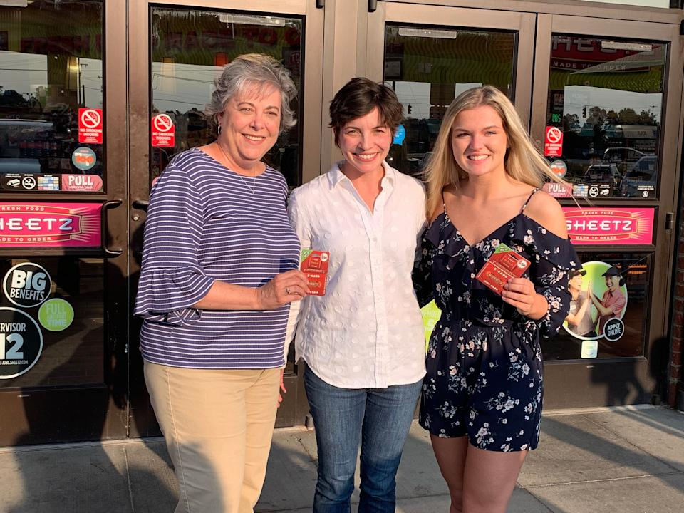 Executive Emily Sheetz (C) gave Sherry Allgood (L) and Devin Bennett (R), a year's worth of gas after their chance meeting at a Sheetz pump. (Photo: Sheetz)