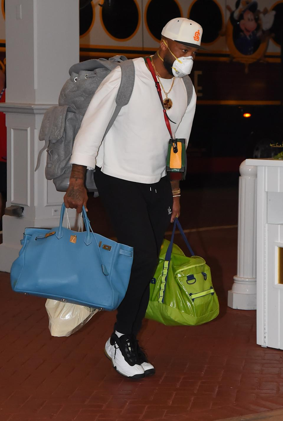 P.J. Tucker carrying an Hèrmes Haut à courroies—also known as the biggest Birkin of them all.