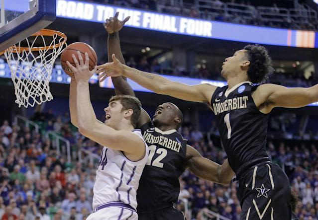 <p>Northwestern forward Gavin Skelly (44) goes to the basket as Vanderbilt's Djery Baptiste (12) and Payton Willis (1) defend during the first half of a first-round men's college basketball game in the NCAA Tournament Thursday, March 16, 2017, in Salt Lake City. (AP Photo/Rick Bowmer) </p>