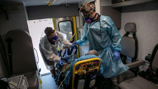 PHOTO: EMS medics transport a man with possible COVID-19 symptoms to the hospital on Aug. 7, 2020 in Austin, Texas. (John Moore/Getty Images)