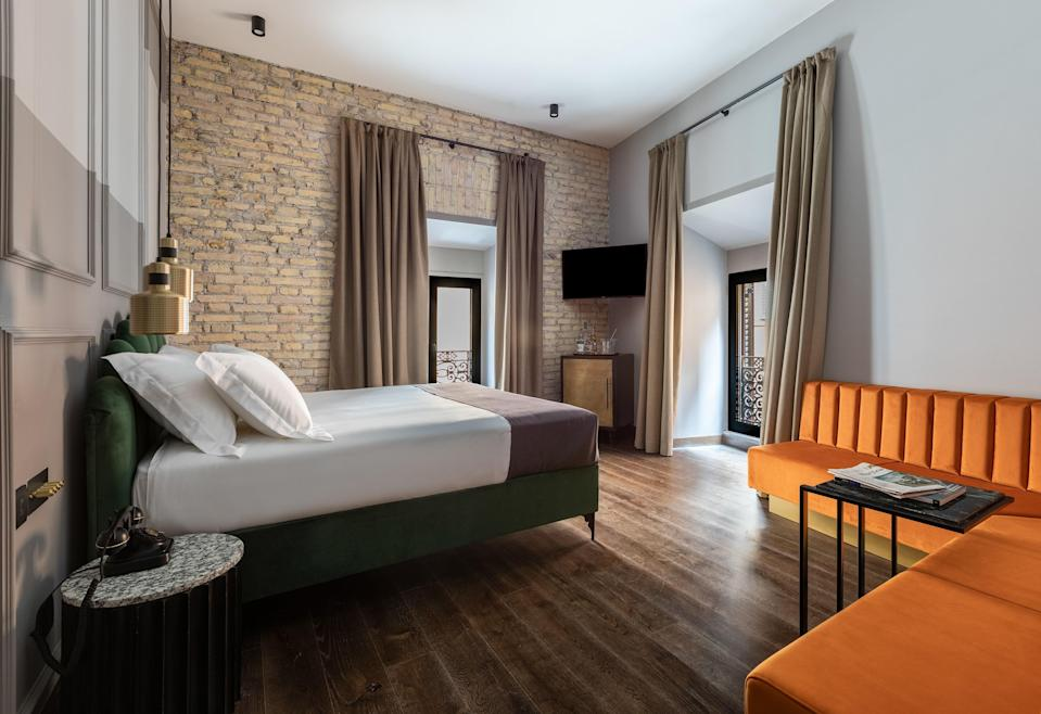 """<p><strong>Kick us off with a description of this place: What's the vibe?</strong><br> Urban and artsy Chapter Roma feels like your coolest friend's very stylish townhouse. The turn-of-the-century palazzo has maintained its original design—including its fabulous staircase and exposed walls—even though it's now a hip pad, complete with works by local and international artists.</p> <p><strong>What's the backstory?</strong><br> This is the very first hotel by Marco Cilia, an alum of several hip hotel start-ups in the United States and Europe. Cilia brought in designer-of-the-moment Tristan Du Plessis to actualize the urban-hip-vibe concept.</p> <p><strong>What can we expect from the rooms?</strong><br> Rooms are among the largest in <a href=""""https://www.cntraveler.com/destinations/rome?mbid=synd_yahoo_rss"""" rel=""""nofollow noopener"""" target=""""_blank"""" data-ylk=""""slk:Rome"""" class=""""link rapid-noclick-resp"""">Rome</a>, with equally large and very comfortable beds. The design melds contemporary details with steampunk; think, custom iron-rod furniture and rich hues. The best room is 404, a top-floor corner room that gets incredible light.</p> <p><strong>How's the Wi-Fi?</strong><br> Free and fast.</p> <p><strong>What's the dining and drinking scene like?</strong><br> The downstairs bar hosts breakfast: a spread of Roman pastries and cakes, with a simple à la carte menu.</p> <p><strong>How'd you find the service?</strong><br> The service is focused and efficient. Playing up the hotel's overall theme, the concierge can organize street art tours.</p> <p><strong>What's the crowd like?</strong><br> If Gucci creative director Alessandro Michele were to make a film, he might pull extras from this hotel.</p> <p><strong>How's the neighborhood?</strong><br> The hotel is on the edge of Rome's historic Jewish quarter in the old Regola neighborhood. It's local and friendly, with lots of home-grown businesses and shops.</p> <p><strong>Anything you'd change?</strong><br> We'd love to see a few more"""