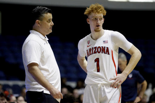 Arizona head coach Sean Miller, left, talks with guard Nico Mannion during a break in the second half of an NCAA college basketball game against Penn at the Wooden Legacy tournament in Anaheim, Calif., Friday, Nov. 29, 2019. (AP Photo/Alex Gallardo)
