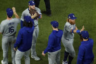 The Los Angeles Dodgers celebrates their win against the Tampa Bay Rays in Game 3 of the baseball World Series Friday, Oct. 23, 2020, in Arlington, Texas. Dodgers beat the Rays 6-2 to lead the series 2-1 games. (AP Photo/David J. Phillip)