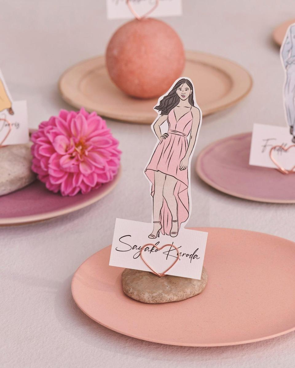 """<h3><a href=""""https://www.etsy.com/listing/814806570/illustrated-wedding-guest-place-cardhttps://www.etsy.com/listing/814806570/illustrated-wedding-guest-place-card"""" rel=""""nofollow noopener"""" target=""""_blank"""" data-ylk=""""slk:Custom Illustrated Place Cards"""" class=""""link rapid-noclick-resp"""">Custom Illustrated Place Cards<br></a></h3><br><em>Party & Paper Category Winner<br></em><br>Josie Kyriacou is a UK-based graphic designer creating personalized paper gifts and place cards that are fabulous for weddings and special events. Each illustration brings to life digital hand-drawn individuals with block colors for a cool, contemporary look that'll certainly <em>wow </em>your guests. <br><br><strong>KyriDesign</strong> Custom Illustrated Place Cards, $, available at <a href=""""https://go.skimresources.com/?id=30283X879131&url=https%3A%2F%2Fwww.etsy.com%2Flisting%2F814806570%2Fillustrated-wedding-guest-place-card"""" rel=""""nofollow noopener"""" target=""""_blank"""" data-ylk=""""slk:Etsy"""" class=""""link rapid-noclick-resp"""">Etsy</a>"""