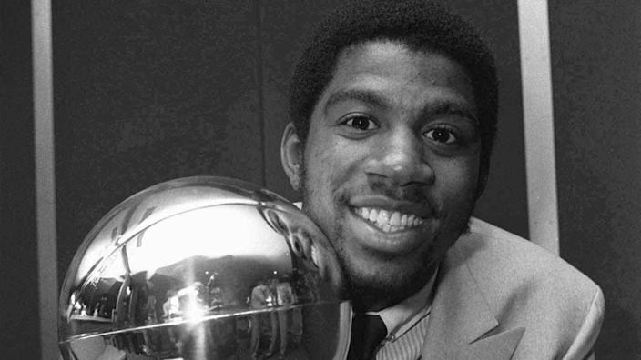 Lakers rookie Magic Johnson holds the Sport Magazine National Basketball Association's trophy.