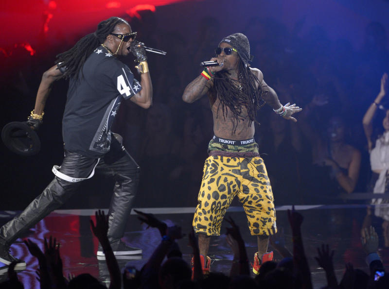 Lil Wayne, right, and 2 Chainz perform at the MTV Video Music Awards on Thursday, Sept. 6, 2012, in Los Angeles. (Photo by Mark J. Terrill/Invision/AP)