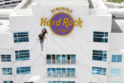 Seventh generation member of the Flying Wallendas, Nik Wallenda - with his 66-year-old mother, Delilah - thrilled guests with a 150-foot-long high wire walk between the two towers of Seminole Hard Rock Hotel & Casino Tampa, following the Grand Celebration guitar smash (counted down by actress Nicole Kidman) on the newly expanded pool deck, 175 feet below.