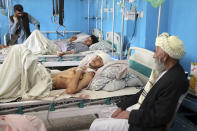 Afghans lie on beds at a hospital after they were wounded in the deadly attacks outside the airport in Kabul, Afghanistan, Friday, Aug. 27, 2021. Two suicide bombers and gunmen attacked crowds of Afghans flocking to Kabul's airport Thursday, transforming a scene of desperation into one of horror in the waning days of an airlift for those fleeing the Taliban takeover. (AP Photo/Wali Sabawoon)
