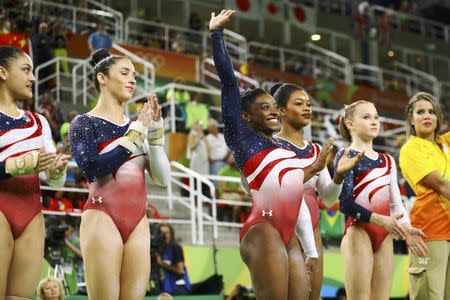 2016 Rio Olympics - Artistic Gymnastics - Final - Women's Team Final - Rio Olympic Arena - Rio de Janeiro, Brazil - 09/08/2016. Simone Biles (USA) of USA (C) is introduced at the women's team final. From L, the USA team are: Laurie Hernandez (USA) of USA, Alexandra Raisman (USA) of USA (Aly Raisman), Biles, Gabrielle Douglas (USA) of USA (Gabby Douglas) and Madison Kocian (USA) of USA. REUTERS/Mike Blake