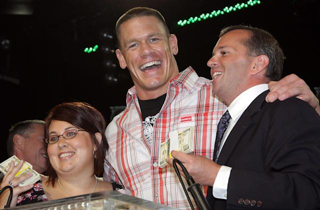 NEW YORK - JUNE 12: WWE superstar John Cena (C) congratulates winners Sarah Furhman (L) and Steve Rosenzweig at the announcement of the First McMahon Million Dollar Mania Winners at the Hard Rock Cafe June 12, 2008 in New York City. (Photo by Will Ragozzino/Getty Images)