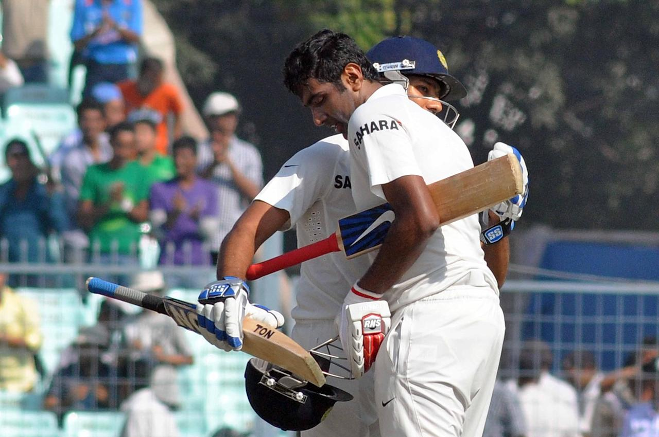 Indian batsman Rohit Sharma congratulates fellow batsman Ravichandran Ashwin after he scored a century during the 3rd day of the 1st test match between India and West Indies at Eden Gardens, Kolkata on Nov. 8, 2013. (Photo: IANS)