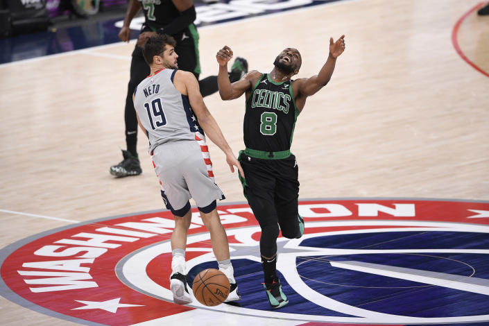 Boston Celtics guard Kemba Walker (8) reacts after he was fouled by Washington Wizards guard Raul Neto (19) during the first half of an NBA basketball game, Sunday, Feb. 14, 2021, in Washington. (AP Photo/Nick Wass)
