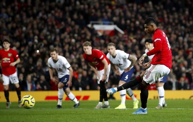 Marcus Rashford slots home the second-half penalty (Martin Rickett/PA)