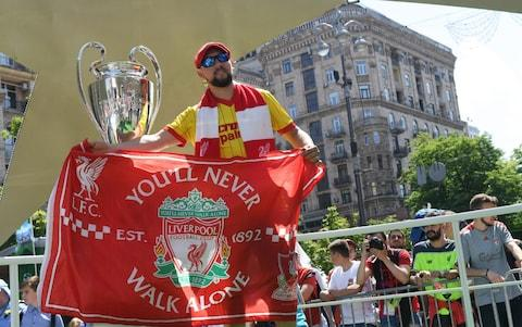 Liverpool fans  - Credit: AFP