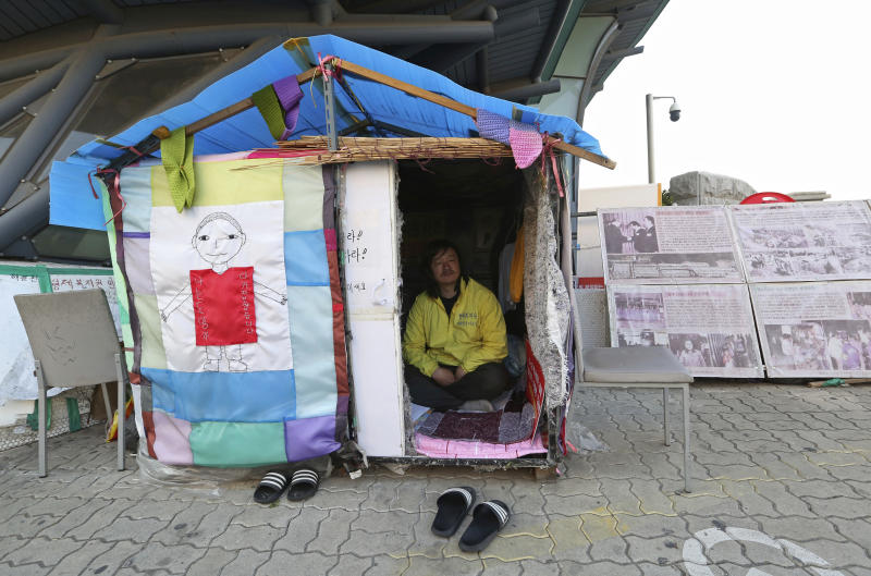 In this April 2, 2019, photo, Choi Seung-woo, a victim of Brothers Home, sits in a tent near the National Assembly in Seoul, South Korea. Choi and a small number of other Brothers Home inmates have been camping out in front of the National Assembly's gate for more than two years calling for lawmakers to pass a bill that would launch a full investigation into past human rights atrocities, including the Brothers Home incident. (AP Photo/Ahn Young-joon)