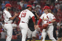 St. Louis Cardinals' Matt Carpenter, left, Alex Reyes, middle, and Harrison Bader celebrate the team's victory over the Minnesota Twins in a baseball game Friday, July 30, 2021, in St. Louis. (AP Photo/Joe Puetz)