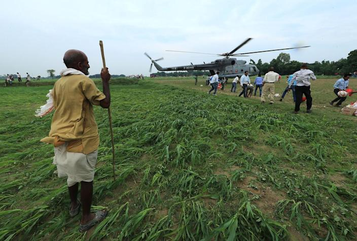 <p>An elderly man looks at the Indian Air Force helicopter as it lands with relief material in a field on the outskirts of Allahabad, India, Friday, Aug. 26, 2016. (AP Photo/Rajesh Kumar Singh)</p>