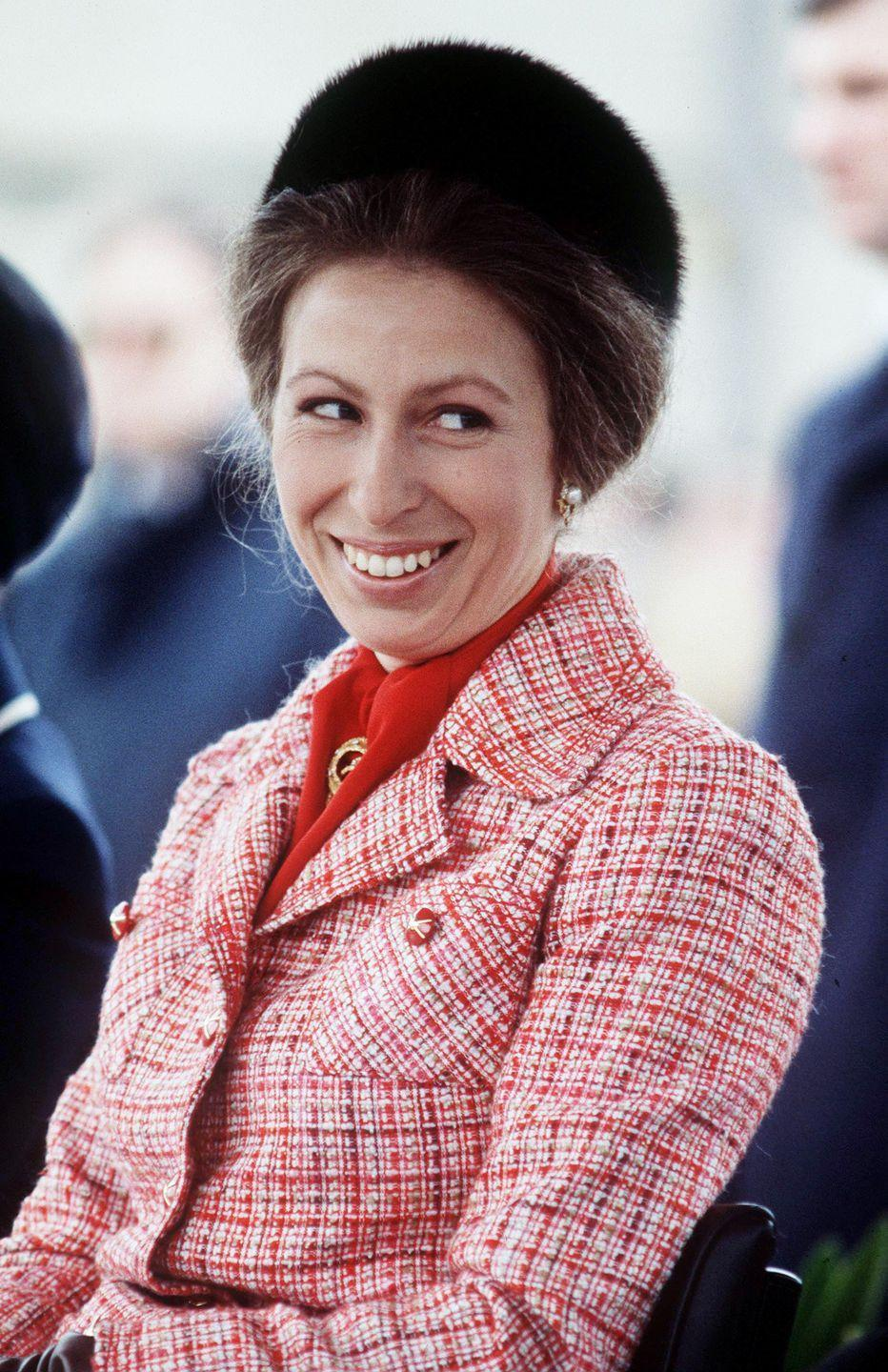 <p>Here, another take on Princess Anne wearing a blazer, but at this 1987 event, it was red tweed boucle paired with a fur pillbox hat. </p>