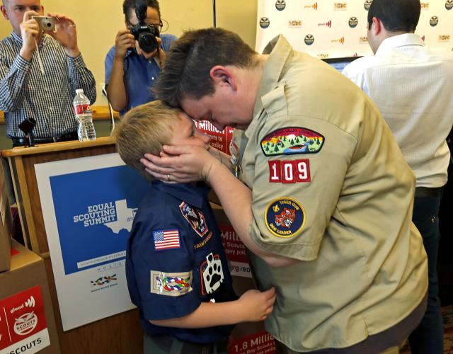 GRAPEVINE, TX - MAY 23: Jennifer Tyrrell of Bridgeport, Ohio, a Cub Scout den leader who was kicked out in 2012 for being openly gay, embraces her son Cruz Burns, 8, before a news conference at the Great Wolf Lodge May 23, 2013 in Grapevine, Texas. The Boy Scouts of America today ended its policy of prohibitting openly gay youths from participating in Scout activities, while leaving intact its ban on gay adults and leaders. (Photo by Stewart House/Getty Images)