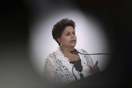 Brazil's President Rousseff speaks during a ceremony to sign concession contracts for duplication of highways in several Brazilian states, at the Planalto Palace in Brasilia
